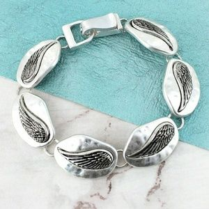Jewelry - HAMMERED SILVERTONE WING DISK MAGNETIC BRACELET